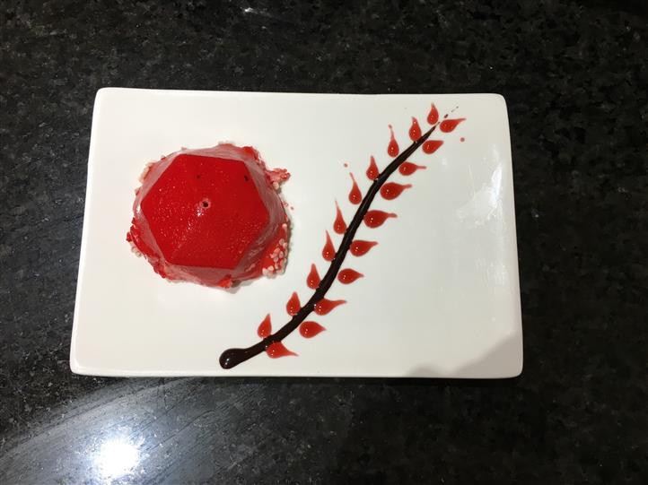 Fruit dessert on dish with syrup design