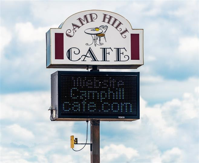 Camp Hill Cafe road sign with electronic readerboard underneath stating website camphillcafe.com