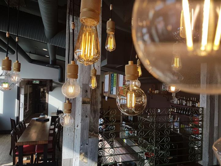 interior area showcasing lightbulbs hanging from the ceiling