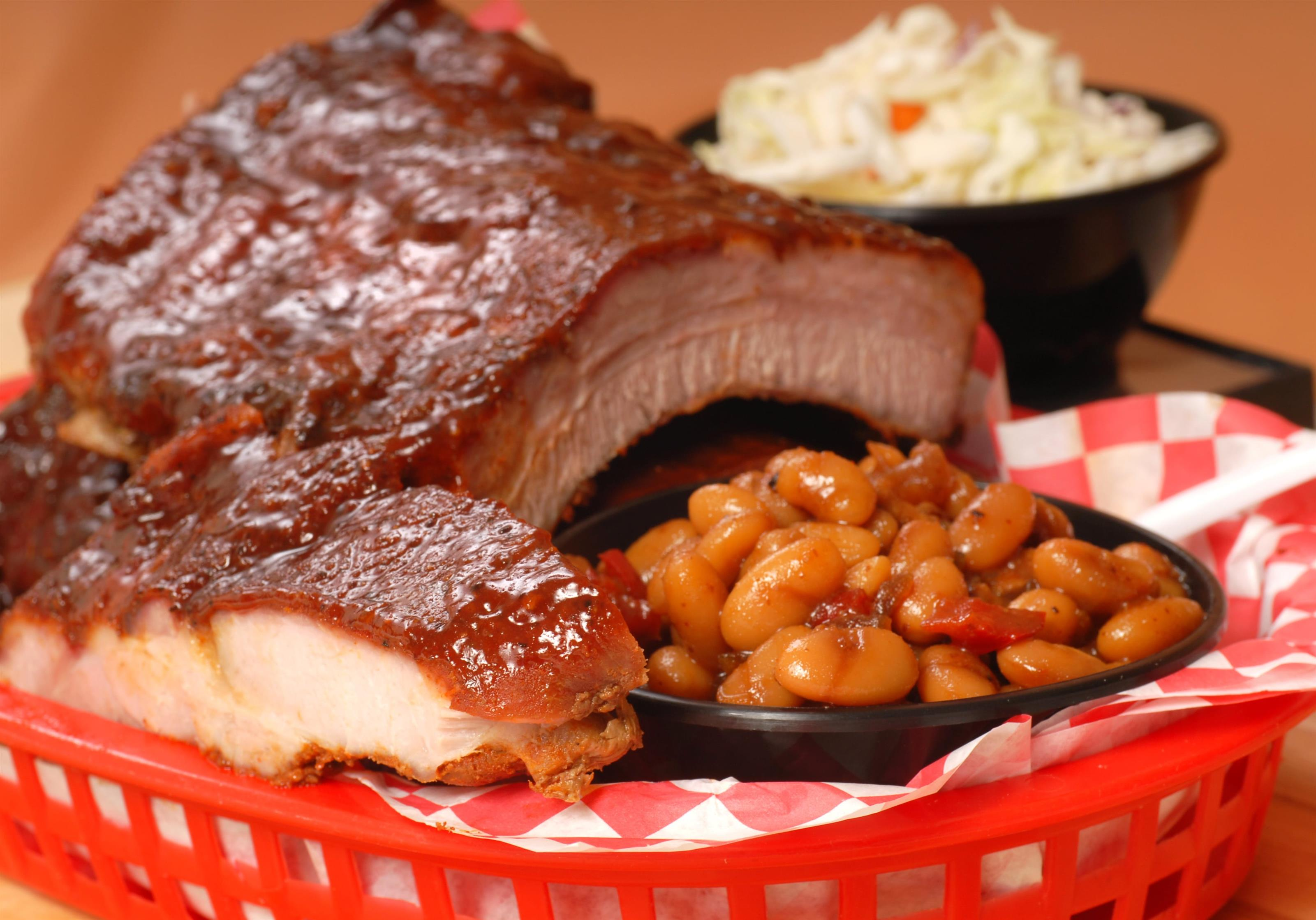 bbq ribs with a side of baked beans and coleslaw