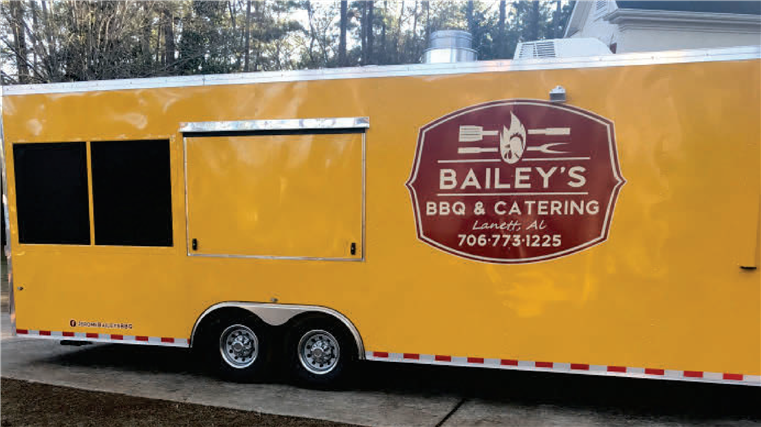 trailor with bailey's bbq and catering logo