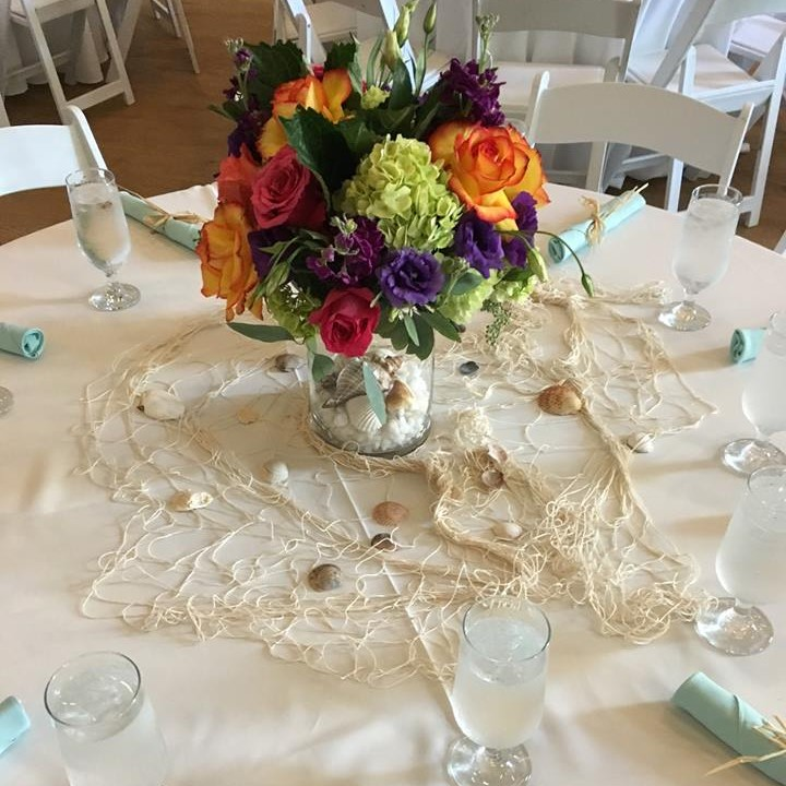 Flowers as centerpiece on covered table