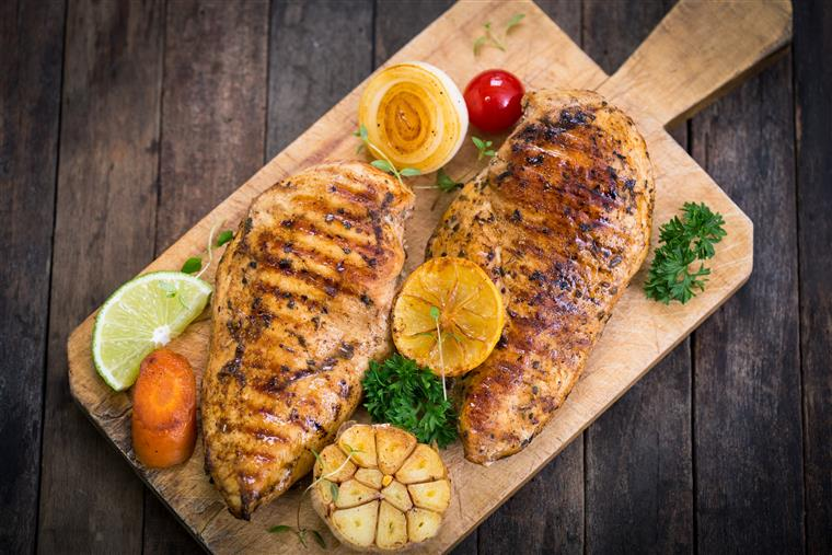 Grilled lemon chicken breast on the cutting board