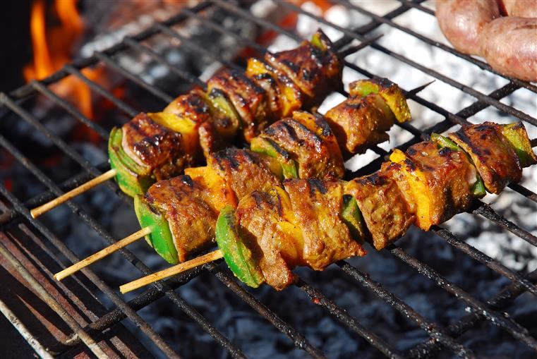 skewers with meat and veggies on the grill