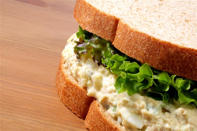 Egg salad sandwich with lettuce on whole wheat bread