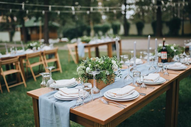 Rustic serving with wood and plant decor