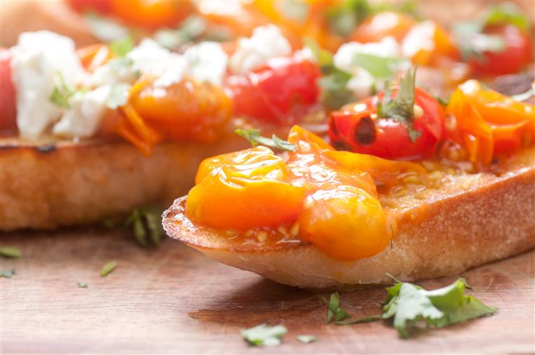 homemade bruschetta with heirloom tomato and goat cheese