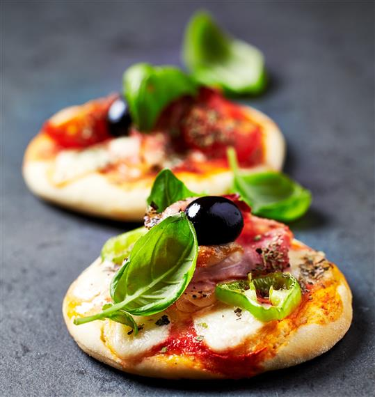 Cracker with cheese and basil