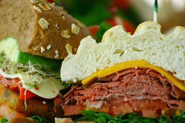 Sandwiches with meat, cheese, microgreens