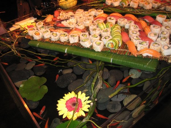 Assorted sushi and sashimi on display table