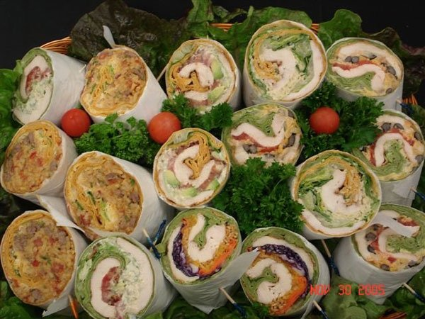 assorted wraps over lettuce garnish