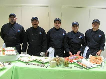 Blueberry Hill event staff behind catering table