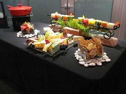 table with display of assorted vegetables, fruits, crackers