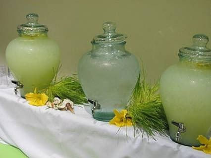 Water and lemonade jugs on table
