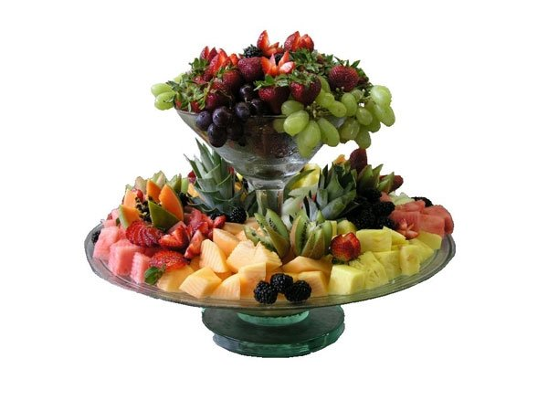 assorted berries, melons, grapes on tiered serving platter