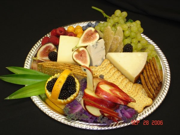 fruit, cheese, cracker display on fancy dish