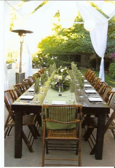 Outdoor wood table with placesettings