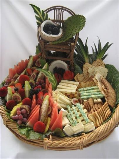 Decorative cracker, cheese, fruit display in basket