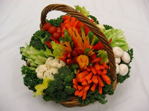Decorative vegetable display in basket and on table
