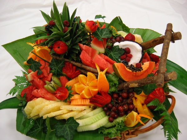 Decorative fruit display in basket and on table