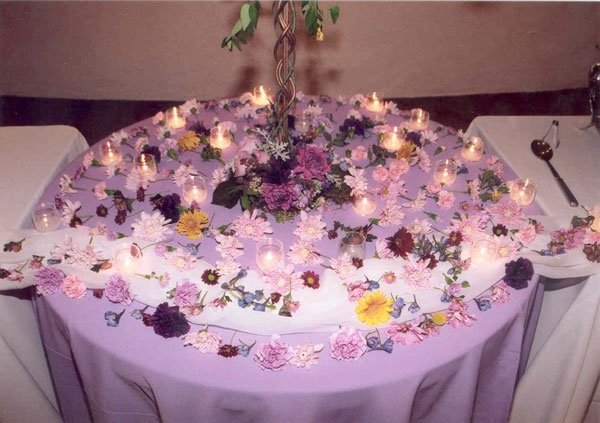 Covered table with decorative flower arrangements