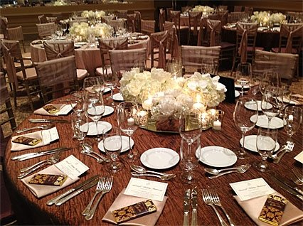 Covered table with placesettings and centerpiece