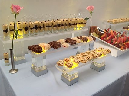 Assorted desserts on displays on table