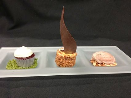 three decorative desserts on fancy dish