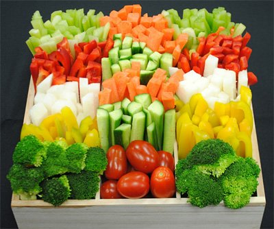 vegetable tray with broccoli, tomatoes, peppers, carrots, celery