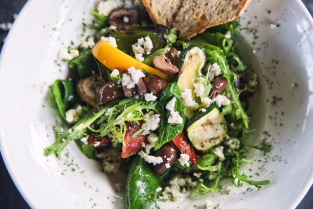 Salad with mixed greens, olives, walnut vinegarette dressing