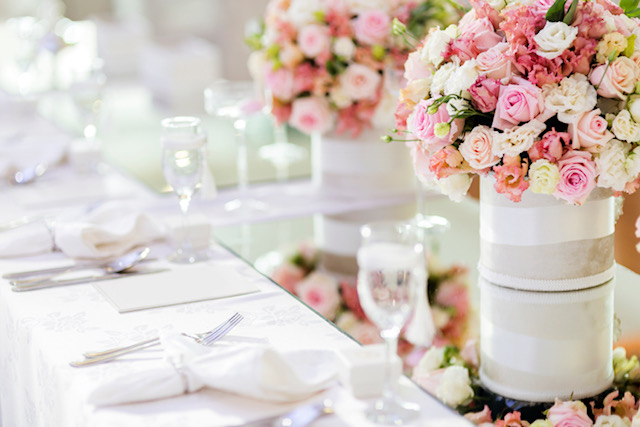 white wedding table settings with pink floral centerpieces