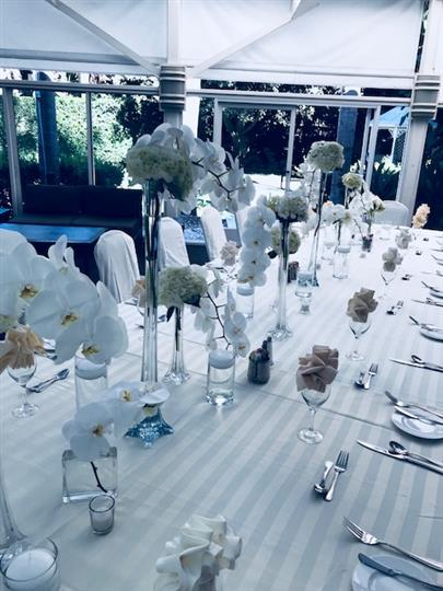 Covered table with placesettings and flowers