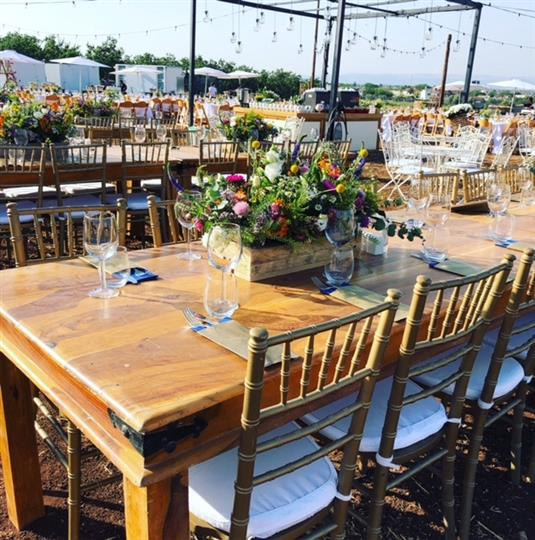 Wood tables in outdoor catering setup