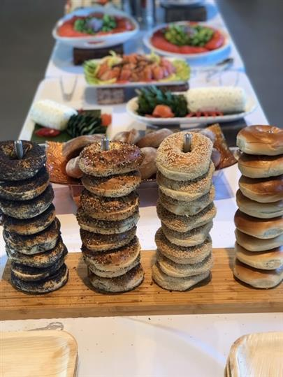 assorted bagels stacked on wood board