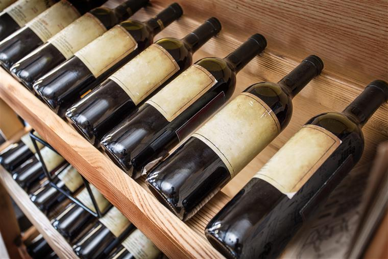 wine bottles on a rack in a cellar
