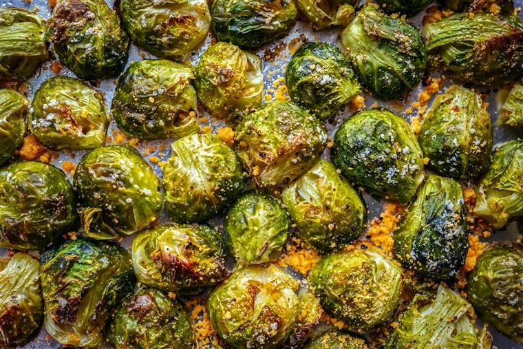 Brussels sprouts roasted in the oven with spices, salt, black pepper and Italian herbs