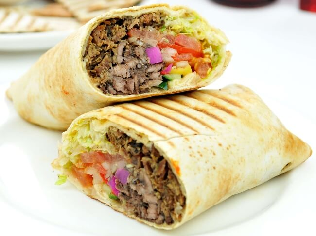 beef wrap with tomato onion and lettuce