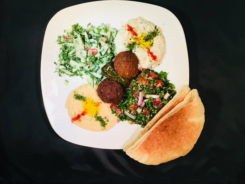 falafel entree with side hummus top view