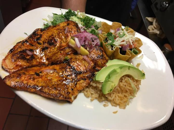 cooked glazed meat with rice and avocado