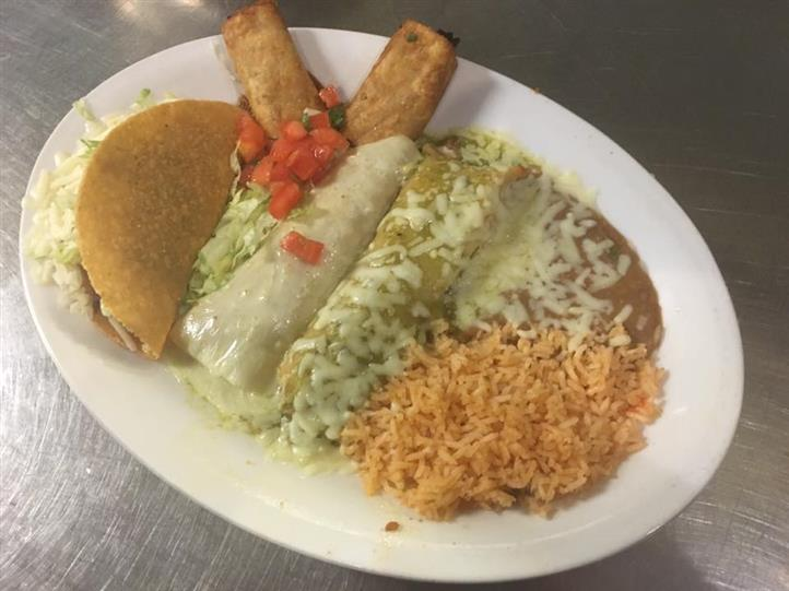 enchilada with rice and beans on a plate