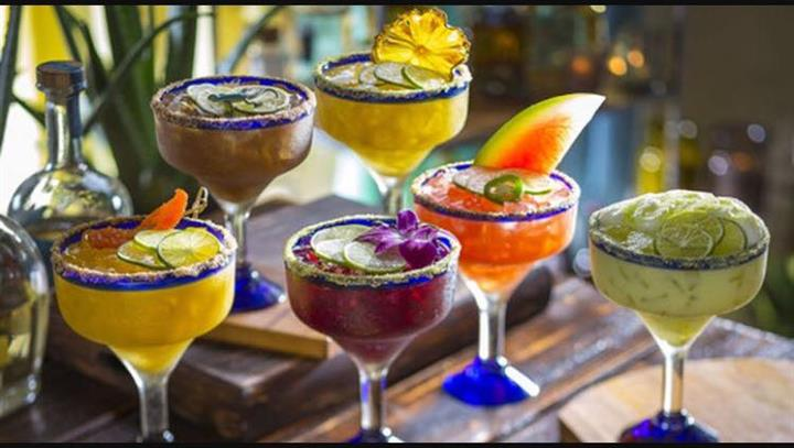 mixed cocktail drinks being displayed