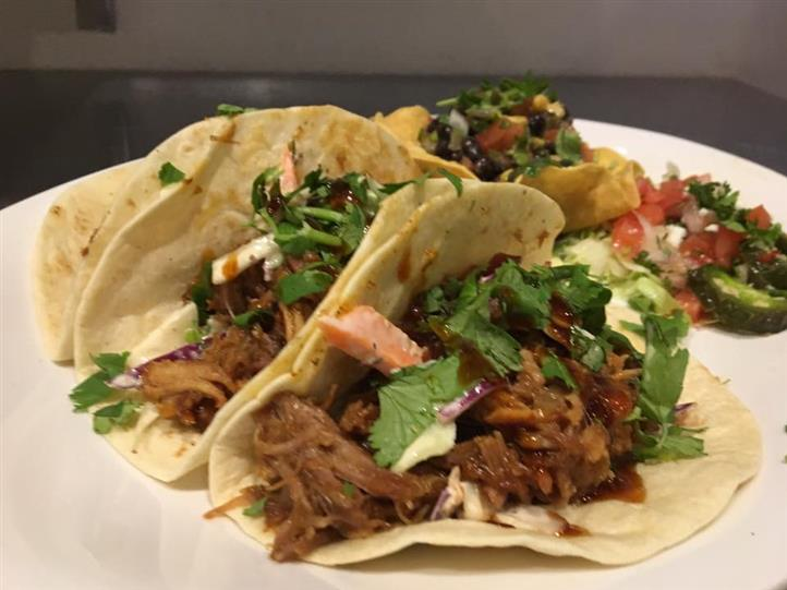 soft shell tacos with pulled meat and herbs
