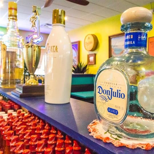 liquor bottles being displayed on the counter