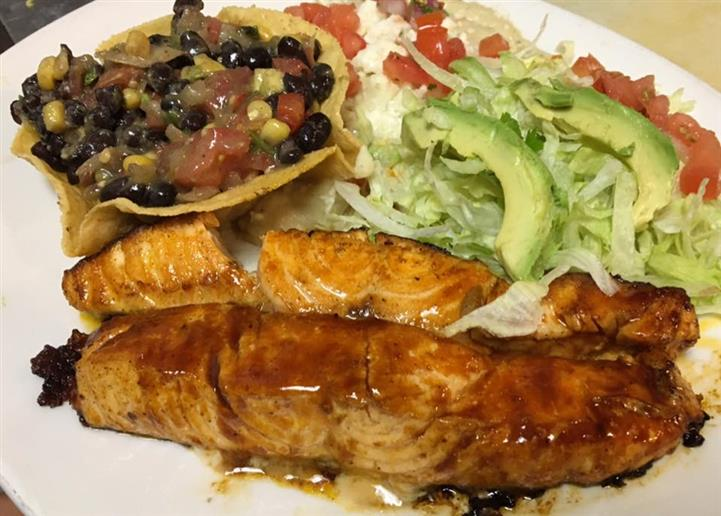 glazed fish with a size of beans and avocado