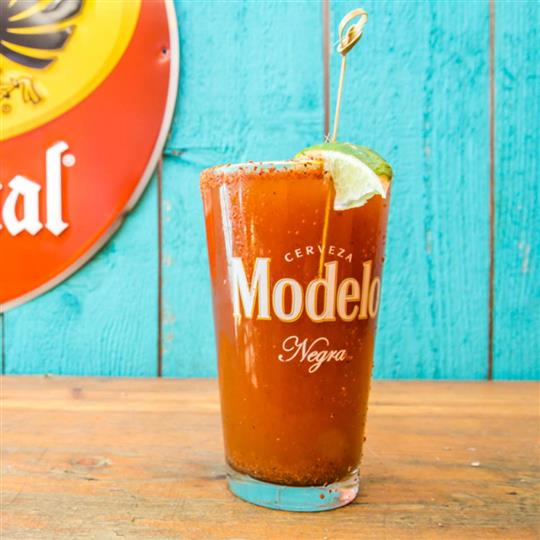modelo glass cocktail drink with a lime wedge