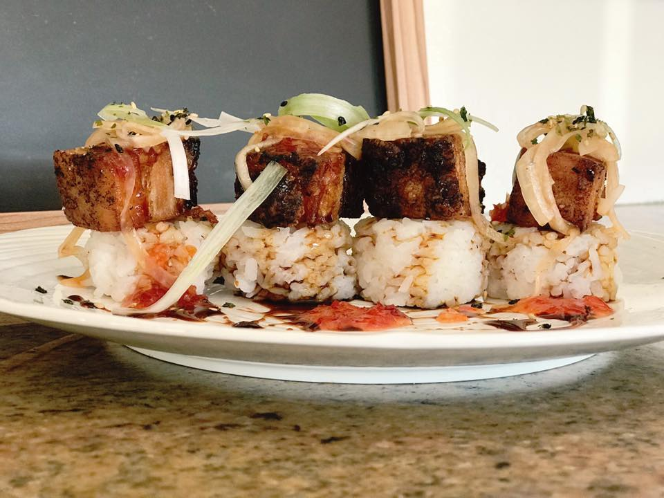 4 pieces of sushi on a dish