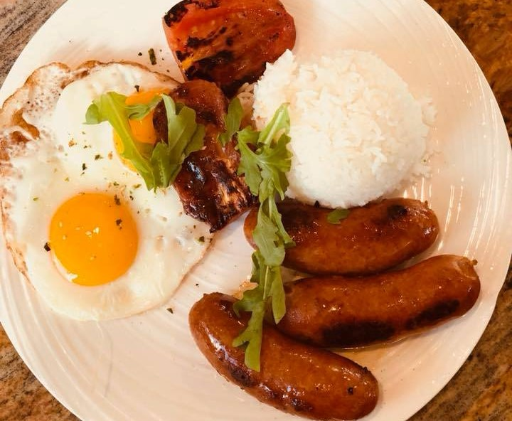 fried egg with sausage and rice