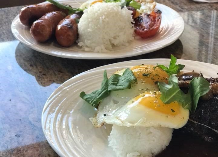 fried eggs with rice and sausage with rice