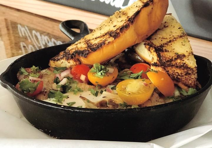 cooked vegetables in a skillet with toast