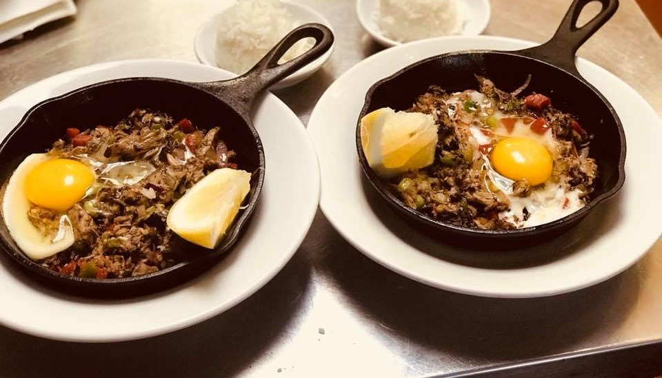 two egg dishes in skillets